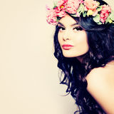 Beautiful Woman with Long Curly Hair and Flowers Wreath Stock Photo