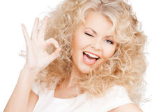 Beautiful woman with long curly hair Stock Photos