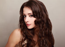 Beautiful woman with long curly hair looking Royalty Free Stock Photos
