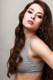 Beautiful woman with long curly hair looking Royalty Free Stock Image