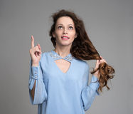 Beautiful woman with long curly hair. Portrait of a beautiful woman with long curly hair Stock Images