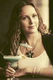 Beautiful woman with long curly hairs at restaurant Royalty Free Stock Photos