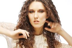 Beautiful woman with long curly hairs Royalty Free Stock Photo