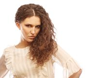 Beautiful woman with long curly hairs Royalty Free Stock Photos