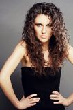 Beautiful woman with long curly hairs Stock Photography