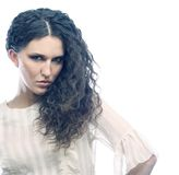 Beautiful woman with long curly hairs Royalty Free Stock Photography