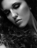 Beautiful woman with long curly hairs Stock Image