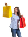 Beautiful woman with long dark hair presenting her shopping bags Stock Photography