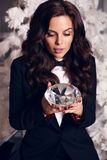 Beautiful woman with long dark hair wearing elegant suit Stock Photography