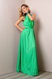 Beautiful woman in a long dress. Stock Photos