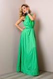 Beautiful woman in a long dress. Stock Photos