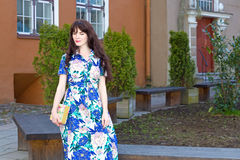 Beautiful woman in long dress walking in old town of Tallinn, Es Stock Photography