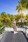 The beautiful woman in a long dress on the wooden bridge.  Royalty Free Stock Photo