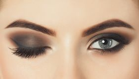 Beautiful woman with long eyelashes and with beautiful evening make-up. royalty free stock photos