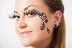 Beautiful woman with long eyelashes and face-art Royalty Free Stock Photography