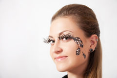 Beautiful woman with long eyelashes and face-art Royalty Free Stock Images
