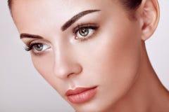 Beautiful woman with long false eyelashes stock photos