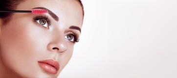 Beautiful woman with long false eyelashes royalty free stock images