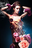 Beautiful woman in long flowers dress Royalty Free Stock Images