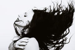 Beautiful woman with long flying hair Royalty Free Stock Image
