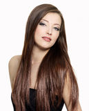 Beautiful woman with long gloss hair royalty free stock photography