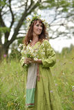 Beautiful woman in a long green dress with flowers Royalty Free Stock Photo