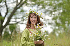 Beautiful woman in a long green dress with flowers Royalty Free Stock Images