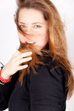 Beautiful woman with long hair. She wears a black shirt Stock Image