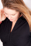 Beautiful woman with long hair. She wears a black shirt Royalty Free Stock Photography