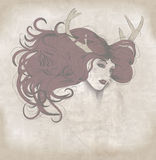 Beautiful woman with long hair and antlers Royalty Free Stock Photography
