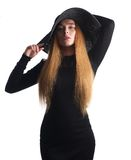 Beautiful woman with long hair and black hat isolated on white royalty free stock photo