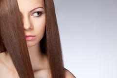 Beautiful woman with long hair, closeup face Stock Photos