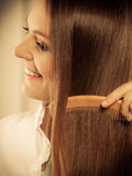 Beautiful woman with long hair and comb Royalty Free Stock Image
