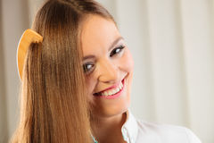 Beautiful woman with long hair and comb Stock Image