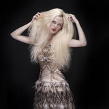 Beautiful woman with long hair on dark background royalty free stock photos