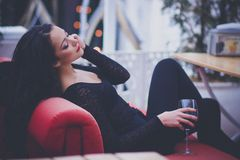 Beautiful woman with long hair drinking red wine in a restaurant Royalty Free Stock Photo