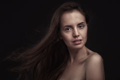 Beautiful woman with long hair and freckles Stock Images
