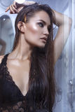 Beautiful woman with long hair in lace lingerie dress taking shower Royalty Free Stock Image