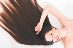 Beautiful woman with long hair, make-up. Fashion. Healthy strong hair Royalty Free Stock Image