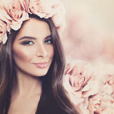 Beautiful Woman with Long Hair, Makeup and Rose Flower Wreath. On Floral Blossom Spring Background Stock Photos