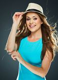 Beautiful woman with long hair in motion holds hat Stock Image