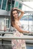 Beautiful woman with long hair posing on bridge at port Royalty Free Stock Photography