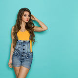 Beautiful Woman With Long Hair Posing In Dungarees stock images