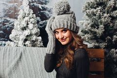 Beautiful woman in gray knit hat and gloves. royalty free stock photo