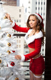 Beautiful Woman with Long Hair  in Santa Outfit Stock Images