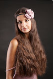 Beautiful woman with long hair in studio. On black Royalty Free Stock Photography