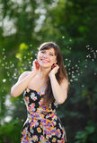 Beautiful woman with long hair in summer park Stock Photos