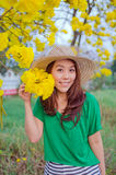 Beautiful woman long hair with yellow flowers, outdoor portrait Royalty Free Stock Image