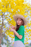 Beautiful woman long hair with yellow flowers, outdoor portrait Stock Photo