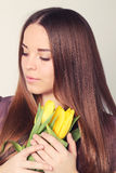 Woman with long hair with yellow tulips Stock Photography
